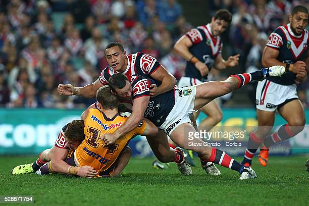 Jarrod Wallace of the Broncos is tackled by Rooster's Boyd Cordner, Sio Siua Taukeiaho and Dylan Napa during the round 24 match between Sydney...