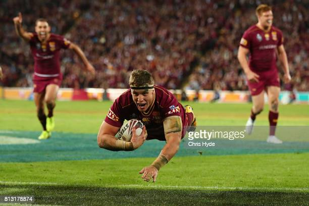 Jarrod Wallace of the Maroons dives to score a try during game three of the State Of Origin series between the Queensland Maroons and the New South...