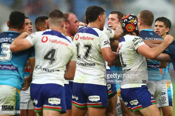 Jarrod Wallace of the Titans and Matthew Lodge of the Warriors grapple during the round 25 NRL match between the Gold Coast Titans and the New...
