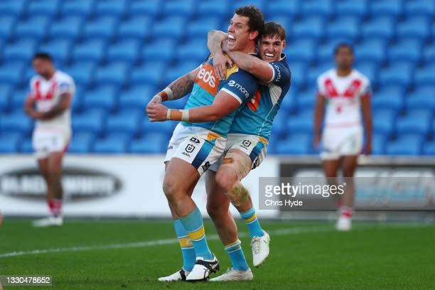 Jarrod Wallace of the Titans celebrates a try during the round 19 NRL match between the St George Illawarra Dragons and the Gold Coast Titans at Cbus...