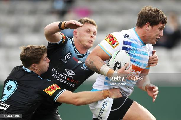 Jarrod Wallace of the Titans heads for the tryline to score during the round 14 NRL match between the Cronulla Sharks and the Gold Coast Titans at...