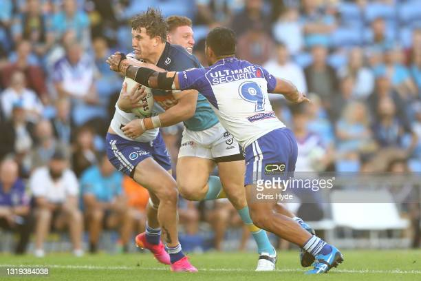 Jarrod Wallace of the Titans is tackled by Dylan Napa of the Bulldogs during the round 11 NRL match between the Gold Coast Titans and the Canterbury...
