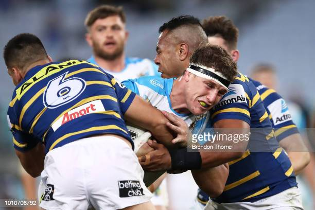 Jarrod Wallace of the Titans is tackled by the Eels defence during the round 21 NRL match between the Parramatta Eels and the Gold Coast Titans at...