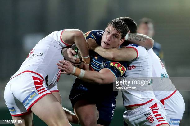 Jarrod Wallace of the Titans is tackled during the round 16 NRL match between the St George Illawarra Dragons and the Gold Coast Titans at Netstrata...
