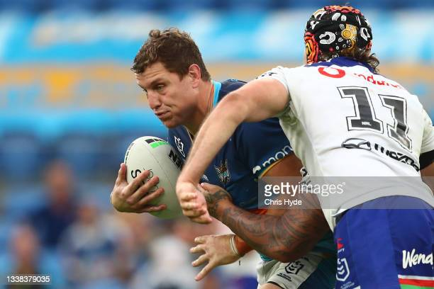 Jarrod Wallace of the Titans is tackled during the round 25 NRL match between the Gold Coast Titans and the New Zealand Warriors at Cbus Super...