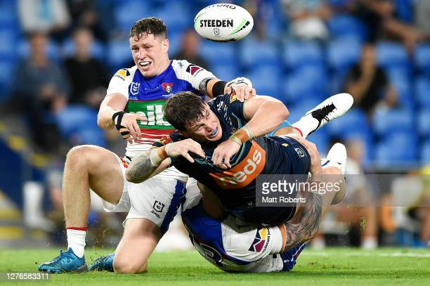 Jarrod Wallace of the Titans loses the ball as he is tackled during the round 20 NRL match between the Gold Coast Titans and the Newcastle Knights at...