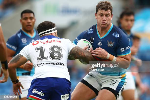 Jarrod Wallace of the Titans runs the ball during the round 25 NRL match between the Gold Coast Titans and the New Zealand Warriors at Cbus Super...