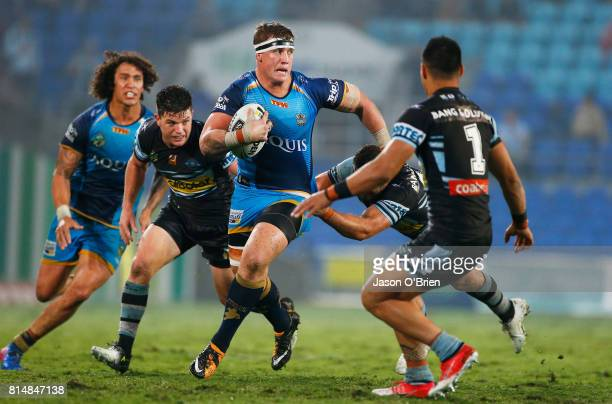 Jarrod Wallace of the Titans runs with the ball during the round 19 NRL match between the Gold Coast Titans and the Cronulla Sharks at Cbus Super...