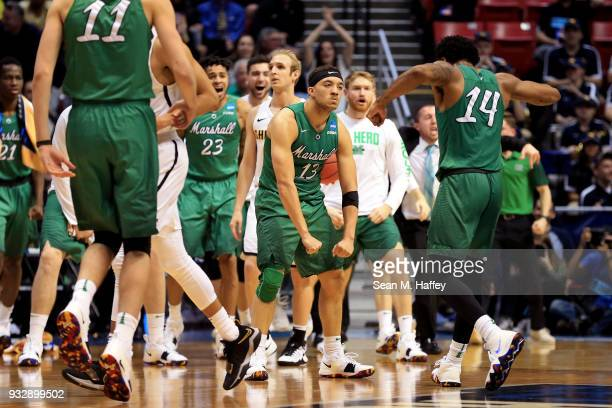 Jarrod West and CJ Burks of the Marshall Thundering Herd celebrate after a play in the second half against the Wichita State Shockers during the...
