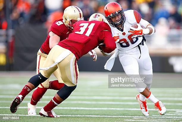 Jarrod West of the Syracuse Orangemen is tackled after catching a pass by Dominique Williams of the Boston College Eagles in the third quarter during...