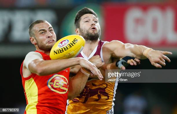 Jarrod Witts competes for posession with Stefan Martin during the round one AFL match between the Gold Coast Suns and the Brisbane Lions at Metricon...
