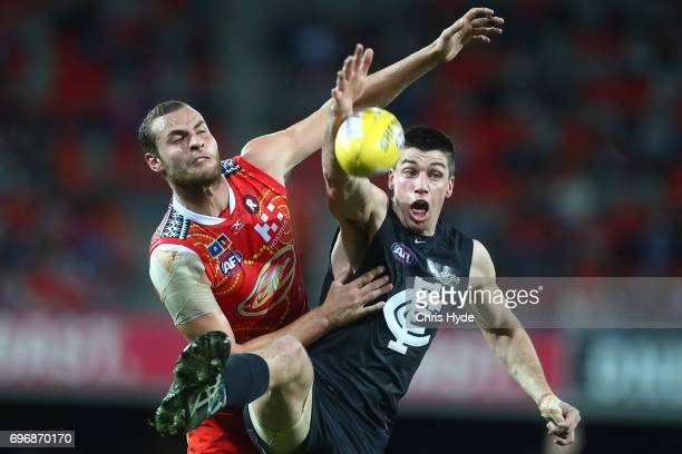 Jarrod Witts of the Suns and Matthew Kreuzer of the Blues compete for the ball during the round 13 AFL match between the Gold Coast Suns and the...