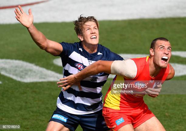 Jarrod Witts of the Suns and Rhys Stanley of the Cats contest the ball during the AFL JLT Community Series match between the Geelong Cats and the...