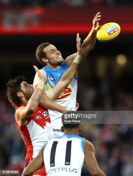 Jarrod Witts of the Suns competes for the ball against Sam Naismith of the Swans during the round 16 AFL match between the Sydney Swans and the Gold...