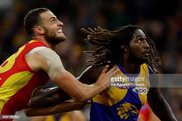 Jarrod Witts of the Suns contests a ruck with Nic Naitanui of the Eagles during the round four AFL match between the West Coast Eagles and the Gold...
