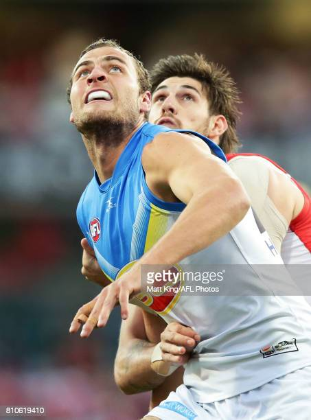 Jarrod Witts of the Suns is challenged by Sam Naismith of the Swans during the round 16 AFL match between the Sydney Swans and the Gold Coast Suns at...