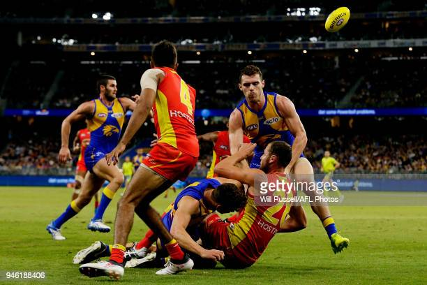 Jarrod Witts of the Suns is tackled by Jack Redden of the Eagles during the round four AFL match between the West Coast Eagles and the Gold Coast...