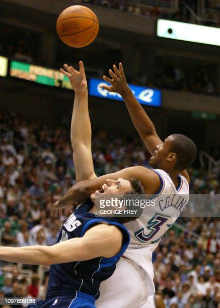 Jarron Collins of the Utah Jazz fights for the ball with Najera Eduardo of the Dallas Mavericks during the first quarter 08 March 2002 in Salt Lake...