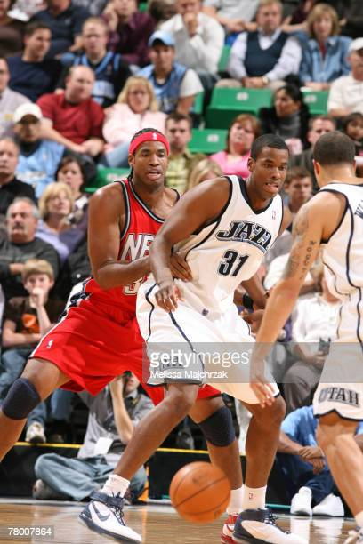 Jarron Collins of the Utah Jazz looks for the ball as his brother Jason Collins of the New Jersey Nets guards him on November 19, 2007 at the...