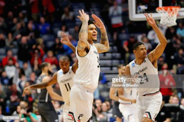 Jarron Cumberland of the Cincinnati Bearcats celebrates after a basket against the Nevada Wolf Pack during the first half in the second round of the...