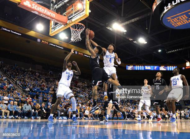Jarron Cumberland of the Cincinnati Bearcats drives to the basket as Jaylen Hands of the UCLA Bruins blocks the layup during the first half at Pauley...