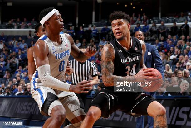 Jarron Cumberland of the Cincinnati Bearcats looks to drive with the ball against Kyvon Davenport of the Memphis Tigers on January 19 2019 at...
