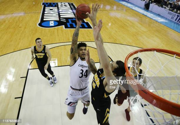 Jarron Cumberland of the Cincinnati Bearcats shoots the ball against Ryan Kriener of the Iowa Hawkeyes in the first round of the 2019 NCAA Men's...