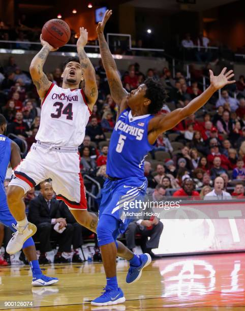 Jarron Cumberland of the Cincinnati Bearcats shoots the ball against Kareem Brewton Jr #5 of the Memphis Tigers at BBT Arena on December 31 2017 in...