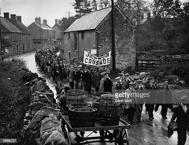 Jarrow marchers passing throught the village of Lavendon near Bedford on their way to London many playing mouth organs to keep spirits up The Jarrow...