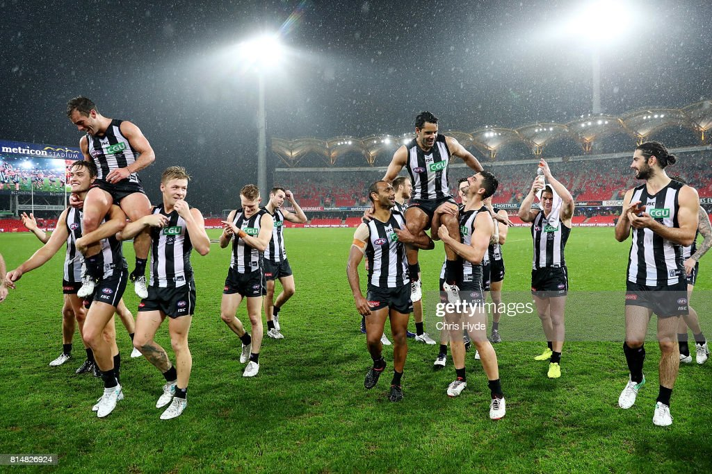 Jarryd Blair and Daniel Wells of the Magpies are chaired from the field after their 150th and 250th match during the round 17 AFL match between the Gold Coast Suns and the Collingwood Magpies at Metricon Stadium on July 15, 2017 in Gold Coast, Australia.