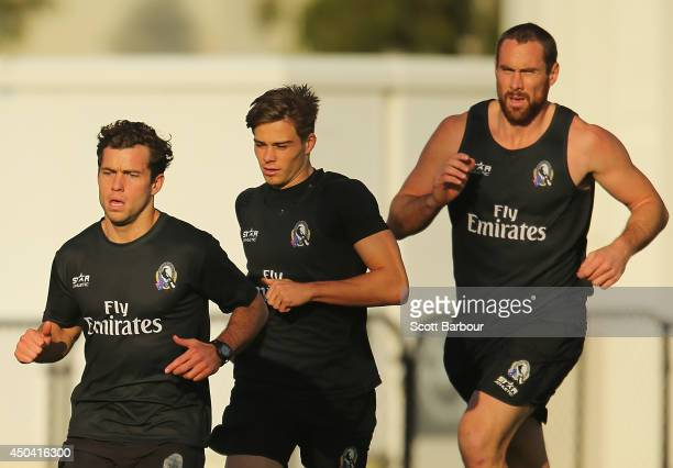 Jarryd Blair, Josh Thomas and Ben Hudson of the Magpies run during a Collingwood Magpies AFL training session at the Westpac Centre on June 11, 2014...
