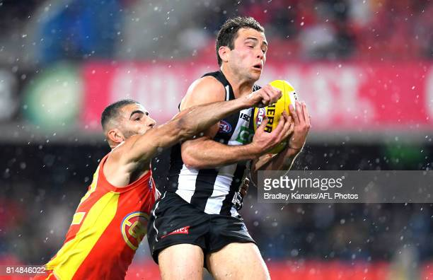 Jarryd Blair of the Collingwood Magpies takes a mark during the round 17 AFL match between the Gold Coast Suns and the Collingwood Magpies at...