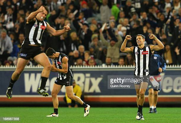Jarryd Blair Scott Pendlebury and Luke Ball of the Magpies celebrate winning the round eight AFL match between the Collingwood Magpies and the...