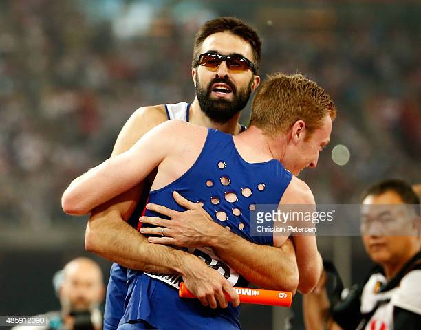 Jarryd Dunn of Great Britain and Martyn Rooney of Great Britain celebrate after winning bronze in the Men's 4x400 Metres Relay final during day nine...