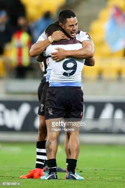 Jarryd Hayne and Apisai Koroisau of Fiji celebrate the win during the 2017 Rugby League World Cup Quarter Final match between New Zealand and Fiji at...