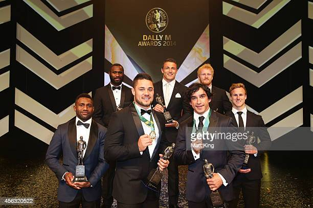 Jarryd Hayne and Johnathan Thurston pose with the team of the year after being presented as joint winners of the Dally M Medal at the Dally M Awards...