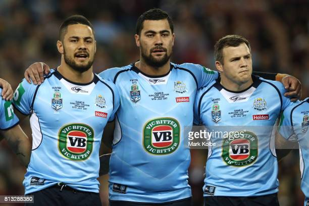 Jarryd Hayne Andrew Fifita and Brett Morris of the Blues sings the National Anthem before game three of the State Of Origin series between the...