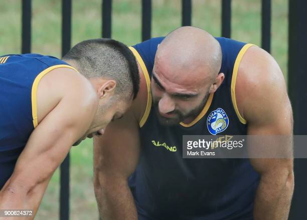 Jarryd Hayne gets encouragment from Club Captain Tim Mannah during a Parramatta Eels NRL preseason training session at Old Saleyards Reserve on...
