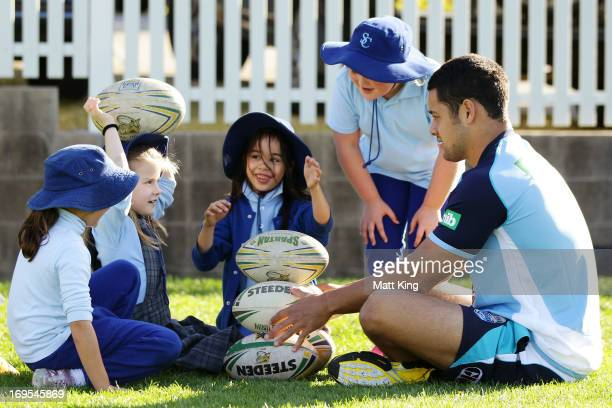 Jarryd Hayne helps out at a kids coaching clinic during a New South Wales Blues State of Origin training session at Coogee Oval on May 27 2013 in...