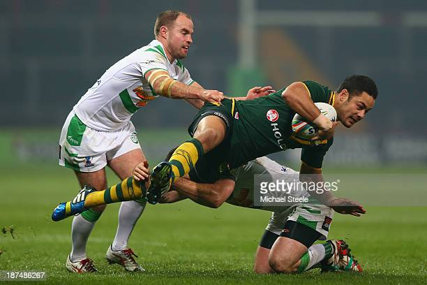Jarryd Hayne of Australia is tackled by Pat Richards and Liam Finn of Ireland during the Rugby League World Cup Group A match between Australia and...