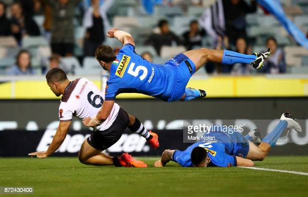 Jarryd Hayne of Fiji crashes over for a try that was later disallowed during the 2017 Rugby League World Cup match between Fiji and Italy at Canberra...