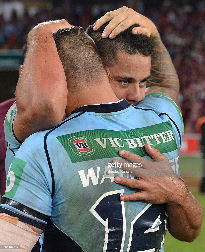 Jarryd Hayne of the Blues and Anthony Watmough of the Blues celebrate victory after game one of the State of Origin series between the Queensland Maroons and the New South Wales Blues at Suncorp Stadium on May 28, 2014 in Brisbane, Australia.