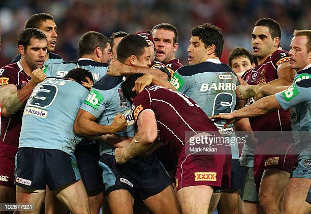 Jarryd Hayne of the Blues and David Shillington of the Maroons trade punches during game three of the ARL State of Origin series between the New...