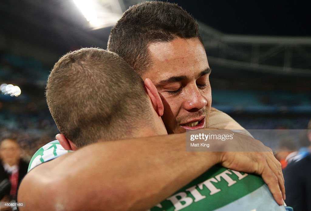 Jarryd Hayne (L) of the Blues celebrates the series victory with Robbie Farah (R) during game two of the State of Origin series between the New South Wales Blues and the Queensland Maroons at ANZ Stadium on June 18, 2014 in Sydney, Australia.