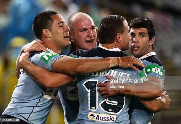 Jarryd Hayne of the Blues celebrates with Michael Weyman, Anthony Watmough and Michael Ennis after scoring a try during game one of the ARL State of...