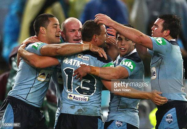 Jarryd Hayne of the Blues celebrates with team mates after scoring a try during game one of the ARL State of Origin series between the New South...