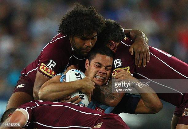 Jarryd Hayne of the Blues is tackled by Sam Thaiday of Maroons during game two of the ARL State of Origin series between the New South Wales Blues...