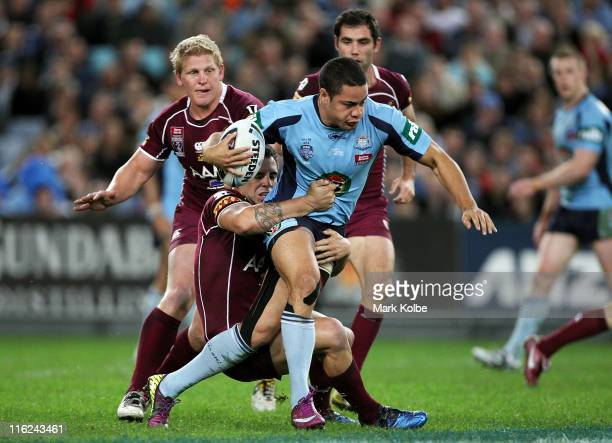 Jarryd Hayne of the Blues is tackled during game two of the ARL State of Origin series between the New South Wales Blues and the Queensland Maroons...