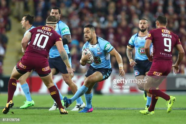 Jarryd Hayne of the Blues runs the ball during game three of the State Of Origin series between the Queensland Maroons and the New South Wales Blues...