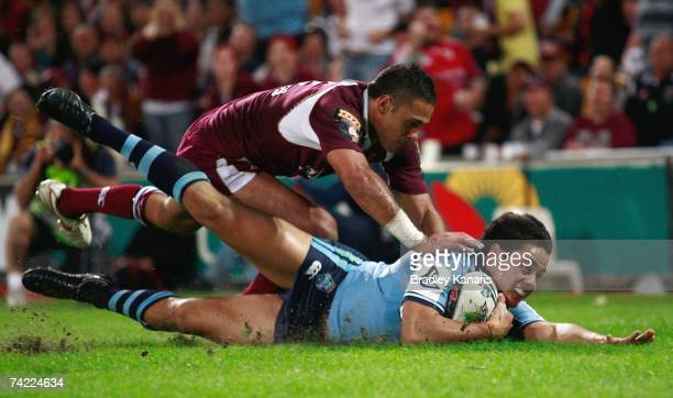 Jarryd Hayne of the Blues scores a try during game one of the State of Origin series between the Queensland Maroons and the New South Wales Blues at...